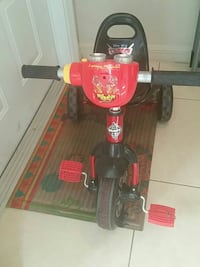 children's red and black Disney Cars trike