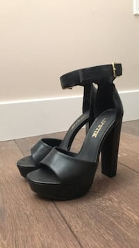 pair of black leather open-toe heeled sandals Vancouver, V5Y 2N7