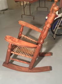 brown wooden rocking chair with red pad Rockland, K4K