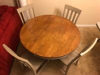 round brown wooden table with four chairs dining set Fairfax, 22032