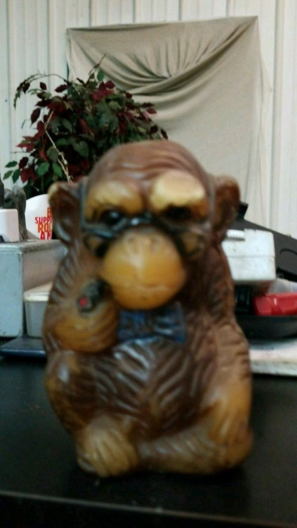 brown and beige monkey ceramic figure