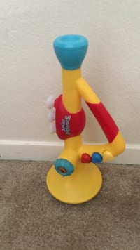 yellow and red trumpet toy
