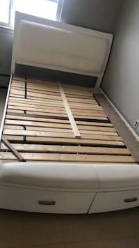 brown and black wooden bed frame 544 km