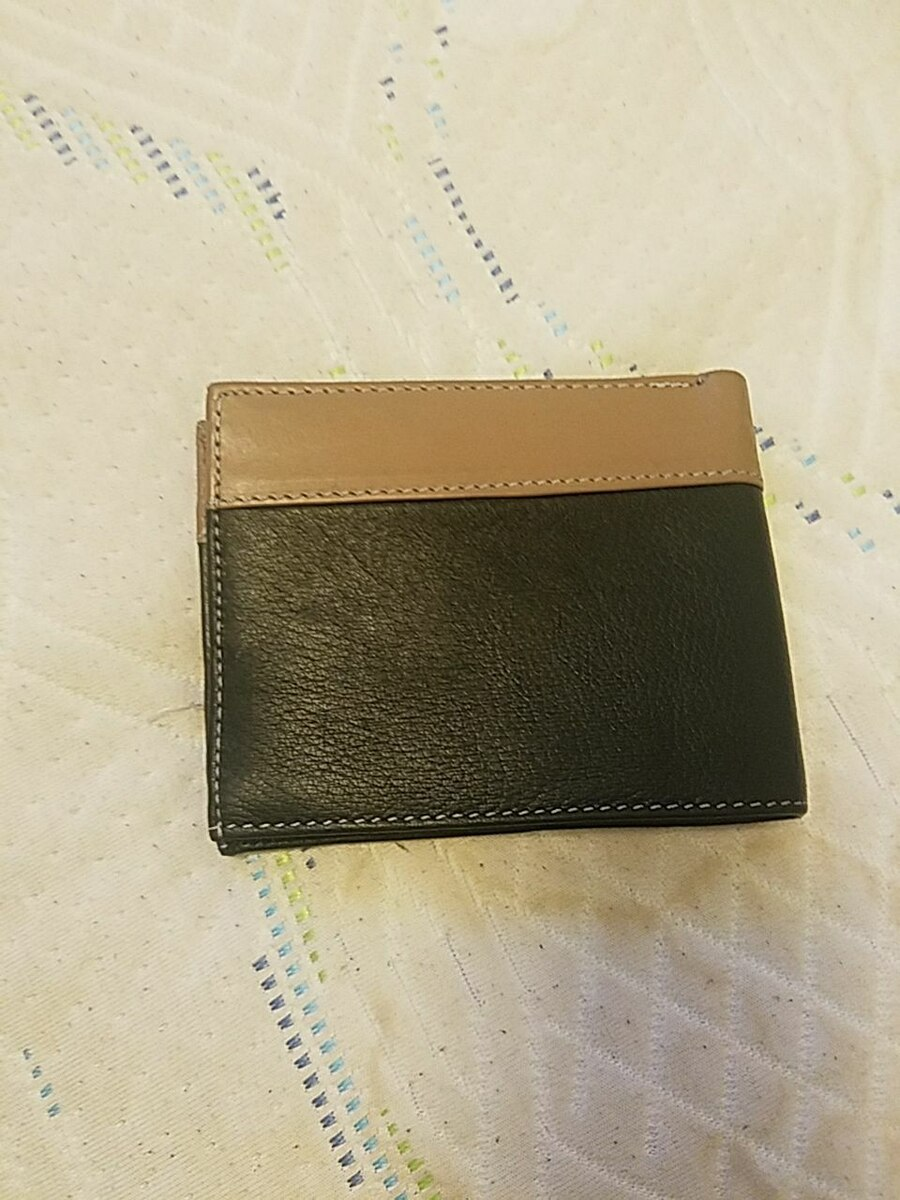 black and brown leather bi-fold wallet