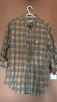 Brown, black, and white burberry flannel