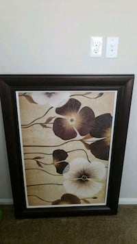 brown wooden framed painting of white petaled flow Reno, 89521