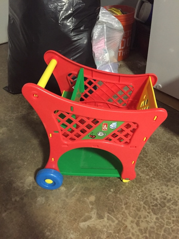 toddler's red and green plastic toy