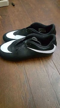 pair of black-and-white Nike cleats Surrey, V3X 1P3