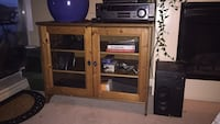 Beautiful tv stand with glass doors. 3735 km