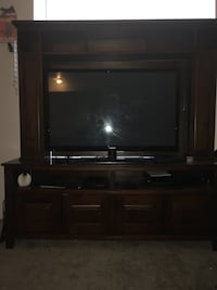 flat screen television with brown wooden TV hutch San Antonio, 78216