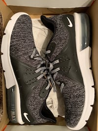 Pair of black nike running shoes Ames, 50010