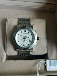 round silver chronograph watch with link bracelet Buena Park