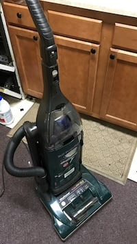 Green upright vacuum cleaner