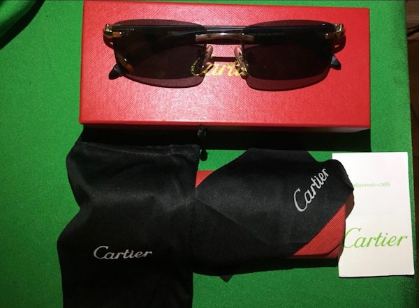 black framed Gucci sunglasses with case