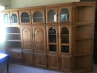 brown wooden TV hutch with flat screen television Gaithersburg, 20879