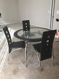 Round glass top table with 3 chairs