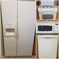 white side-by-side refrigerator, white gas range oven, white range-top microwave, and white dishwasher
