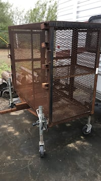 brown metal pet cage with wheels