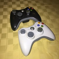 1 White and 2 black Xbox 360 game controller