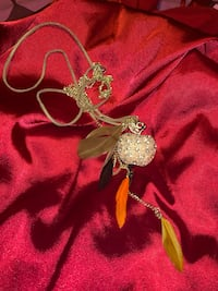 Massive long apple necklace with feathers
