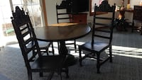 Solid wood table with four chairs leather seats and backs press on the top with pineapples beautiful set came out about a hotel in Stillwater Crystal, 55422