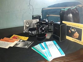 A-1 vintage canon camera with multiple lens features and flash