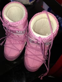 pair of pink moon boots 48 km