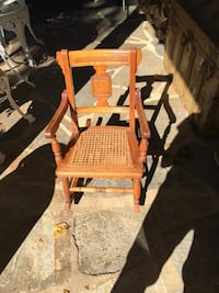 Child's antique wooden rocking chair with perfect cane seat.  Gwynn Oak, 21207