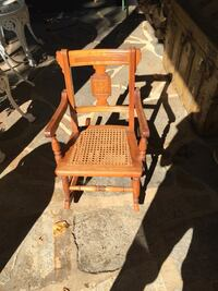 Child's antique wooden rocking chair with perfect cane seat.