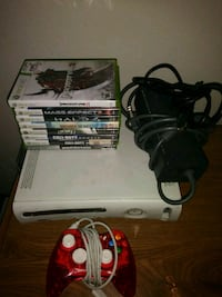 white Xbox 360 console with controller and game ca