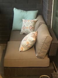 Two patio chairs with cushions and tags attached Minneapolis, 55401