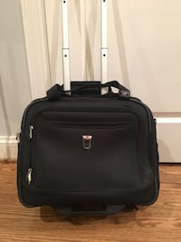 Never used black luggage / laptop bag.