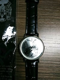 round silver analog watch with black leather strap Albuquerque, 87107