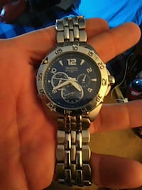 round black and silver chronograph watch with silv Leavenworth, 66048