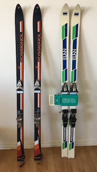 two pairs of black and beige snow skis