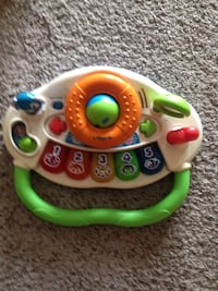 white and green Vtech learning toy