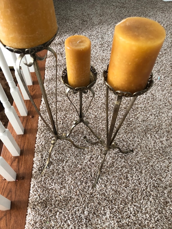 two brown wooden candle holders