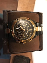 Authentic Michael Kors gold and black watch in great condition haven't been worn much  Camden, 29020