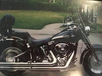 Black 100th anniversary Harley 2003 fatboy with accessories