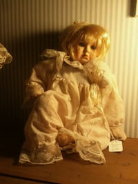 brown and white dressed porcelain doll Kingsport, 37664