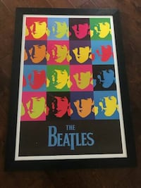 The Beatles poster and black wooden frame