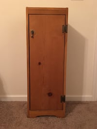 Rustic cabinet with fold out ironing bosrd West Columbia, 29170