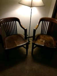 2 brown soled wooden  chairs 606 mi