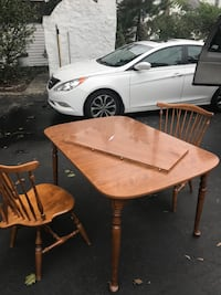 round brown wooden table with four chairs dining set Johnston, 02919