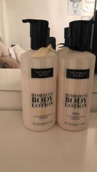 two Victoria's Secret Hydrating Body Lotion pump bottles