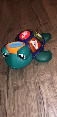 Kids toy. Makes sounds and lights up. Smoke free home.