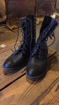 pair of black leather combat boots Frederick, 21701