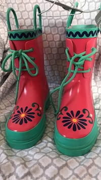 pair of red-black-and-green rain boots