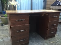 brown wooden single pedestal desk North Vancouver, V7H 1V5