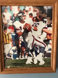 brown wooden framed autographed photo of football player